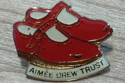 Aimee Drew Trust little red shoes logo